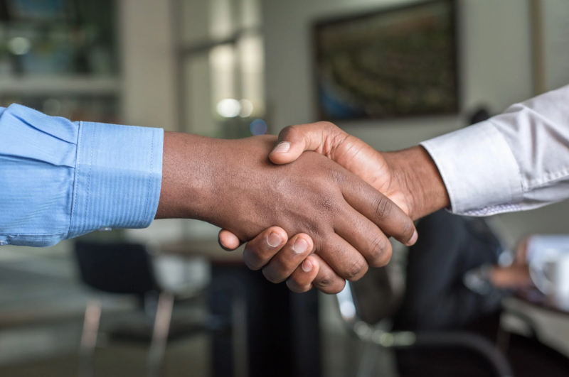 Sales decision makers shaking hands
