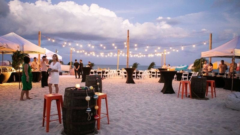 event on beach with string lighting