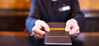 hotel employee handing over credit card to customer